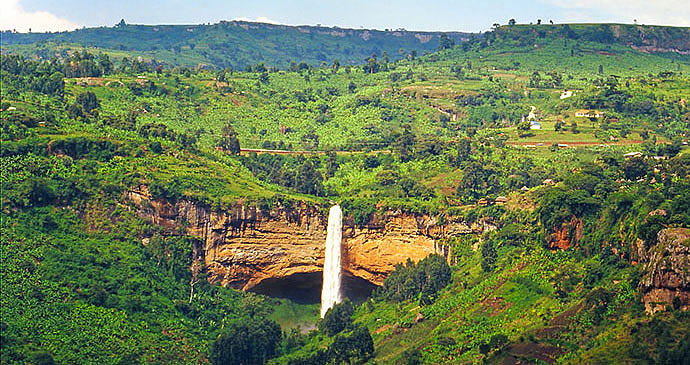 Open fields of Uganda with Sip Falls in the forefront