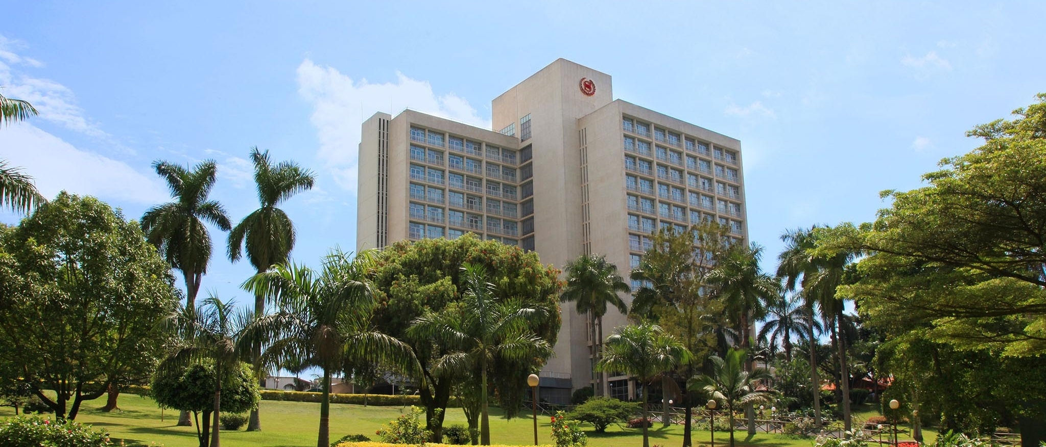 Sheraton Kampala Hotel External View with trees in foreground